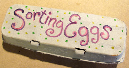 Sorting Easter eggs egg carton