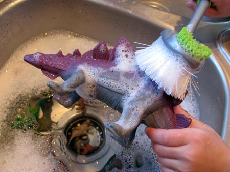 washing paint off dinosaurs