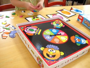Playing Colorforms Silly Faces game