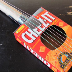 Make a toy guitar out of recycled materials