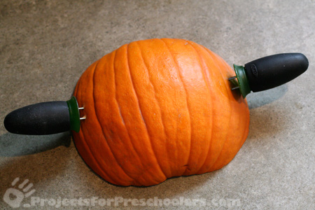 Stick corn holders into side of pumpkin stamp