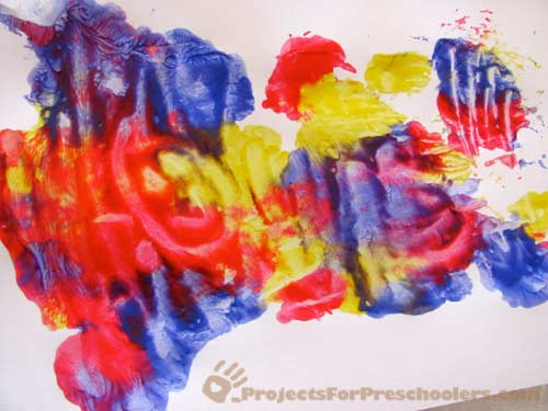 make a finger painting between wax paper