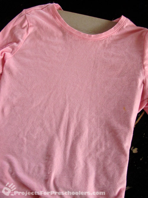 place cardboard inside shirt
