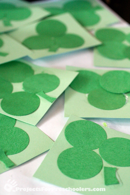 Making shamrocks and 4 leaf clovers from paper circles