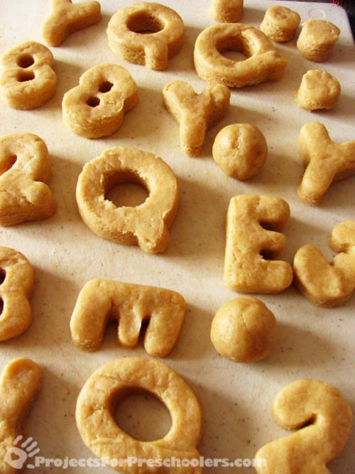 alphabet doughnuts cut out and ready to cook