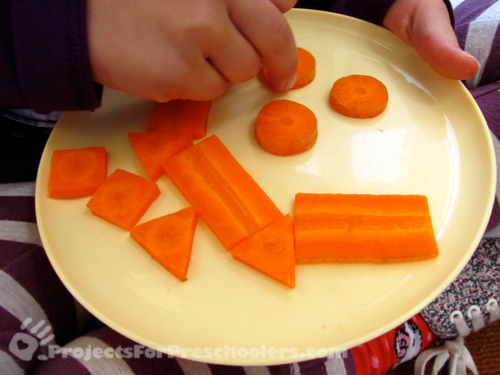 making a smiley face with cut carrots