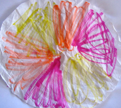 Color the coffee filter with washable markers