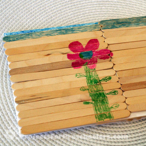 Coloring on popsicle sticks with markers