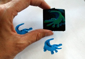 Use craft paints and stamps to decorate your frame