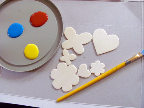 Paint, wood shapes and paint brush