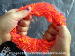 make a circle with a fuzzy pipe cleaner