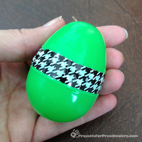 Finished plastic egg decorating with fun tape