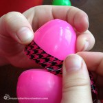 Decorating plastic Easter eggs with tape
