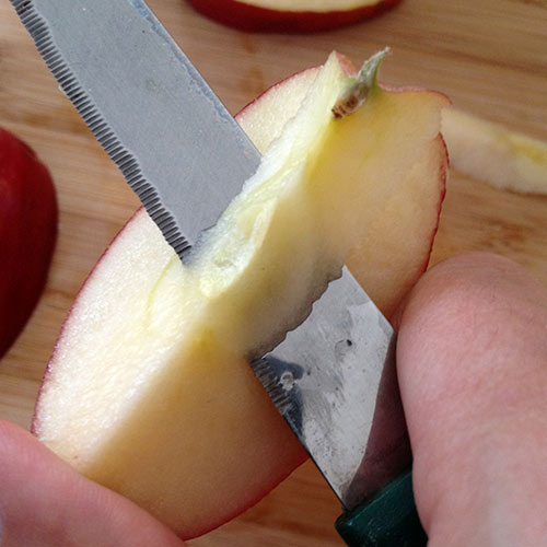 Cut out core of apple slices